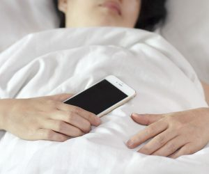 I Accidentally Slept on My Phone. What Are the (Health) Risks?